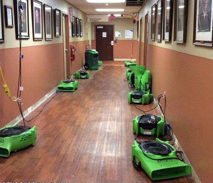 Air movers in a hall way